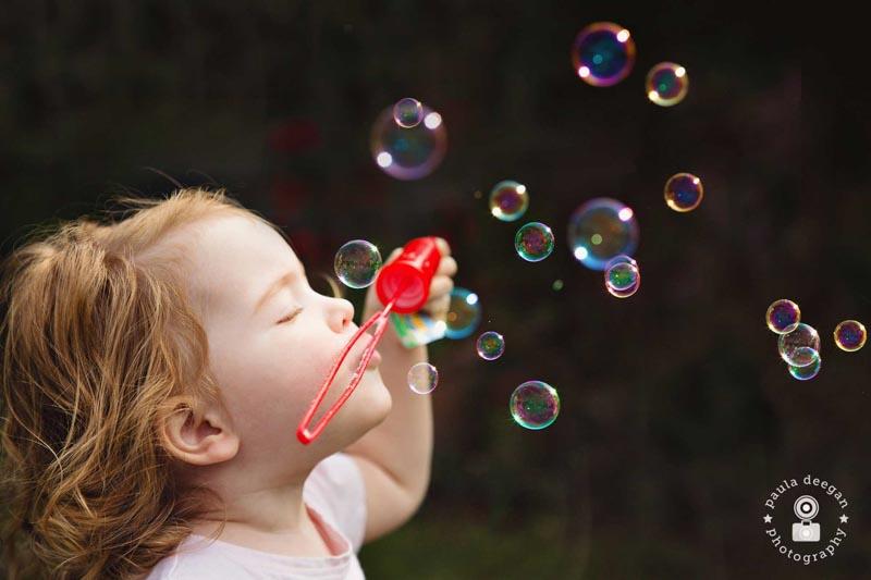 child photographer surrey | blowing bubbles