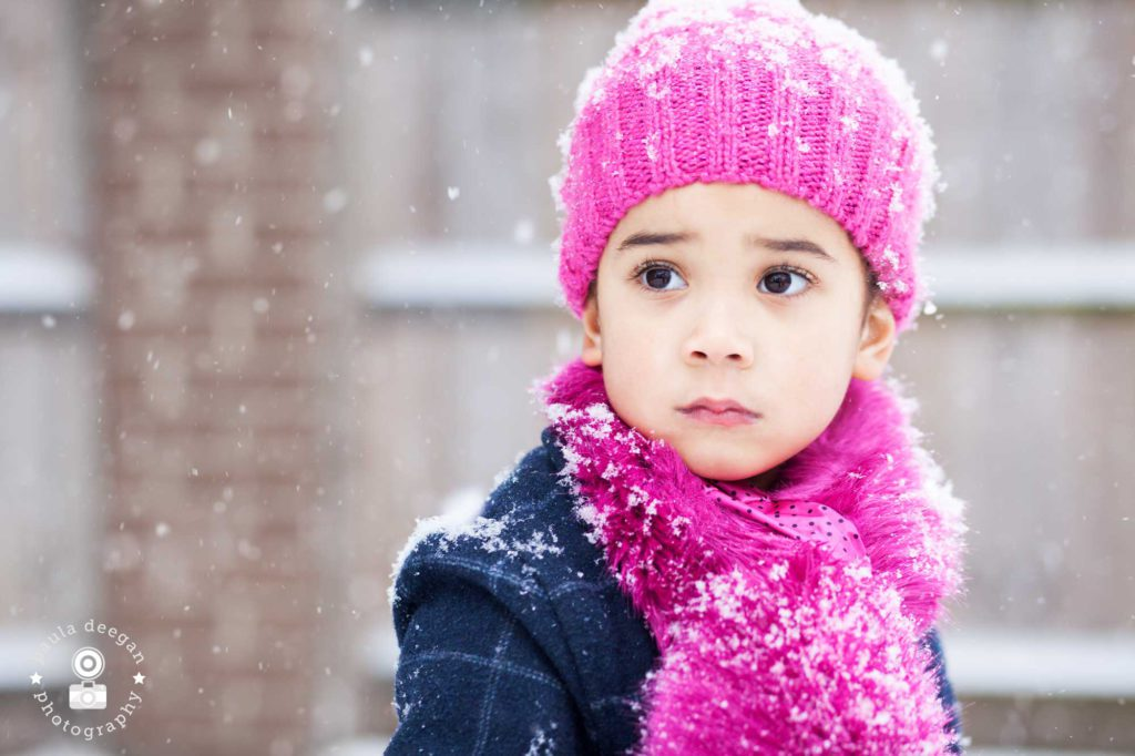 child in snowy winter photoshoot