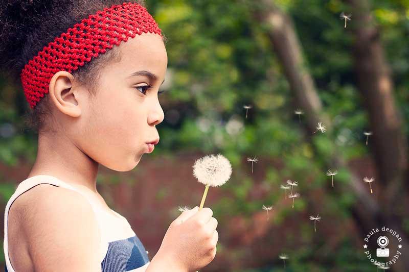 Girl blowing a dandelion | Paula Deegan Photography